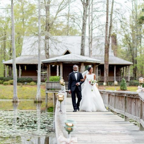 bride and groom walking walkway