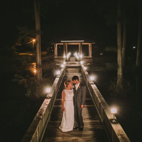 lodge walkway to gazebo at night with bride n groom